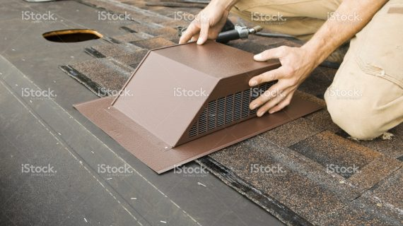 stock-photo-18176864-installing-attic-vent-on-home-roof-replacement-project