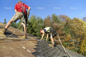 stock-photo-35230536-roofers-with-safety-equipment