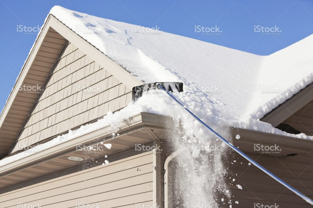 stock-photo-35593844-roof-rake-removing-winter-snow