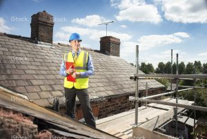 stock-photo-46927946-building-inspector-assesses-slate-roof-condition