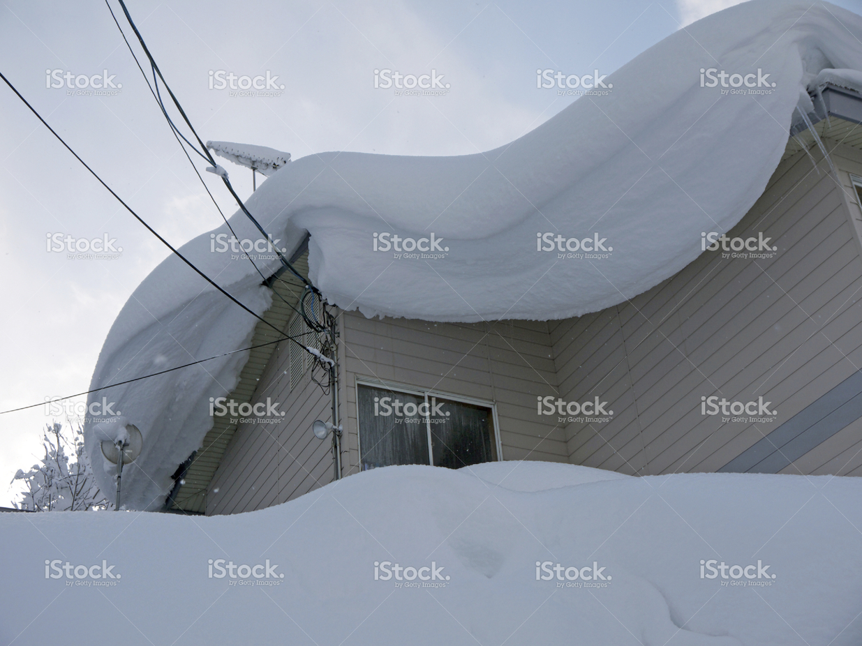 stock-photo-59871580-heavy-snowdrift-on-the-roof